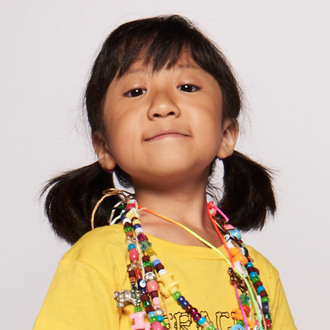 SickKids patient with pig tails and Bravery Beads