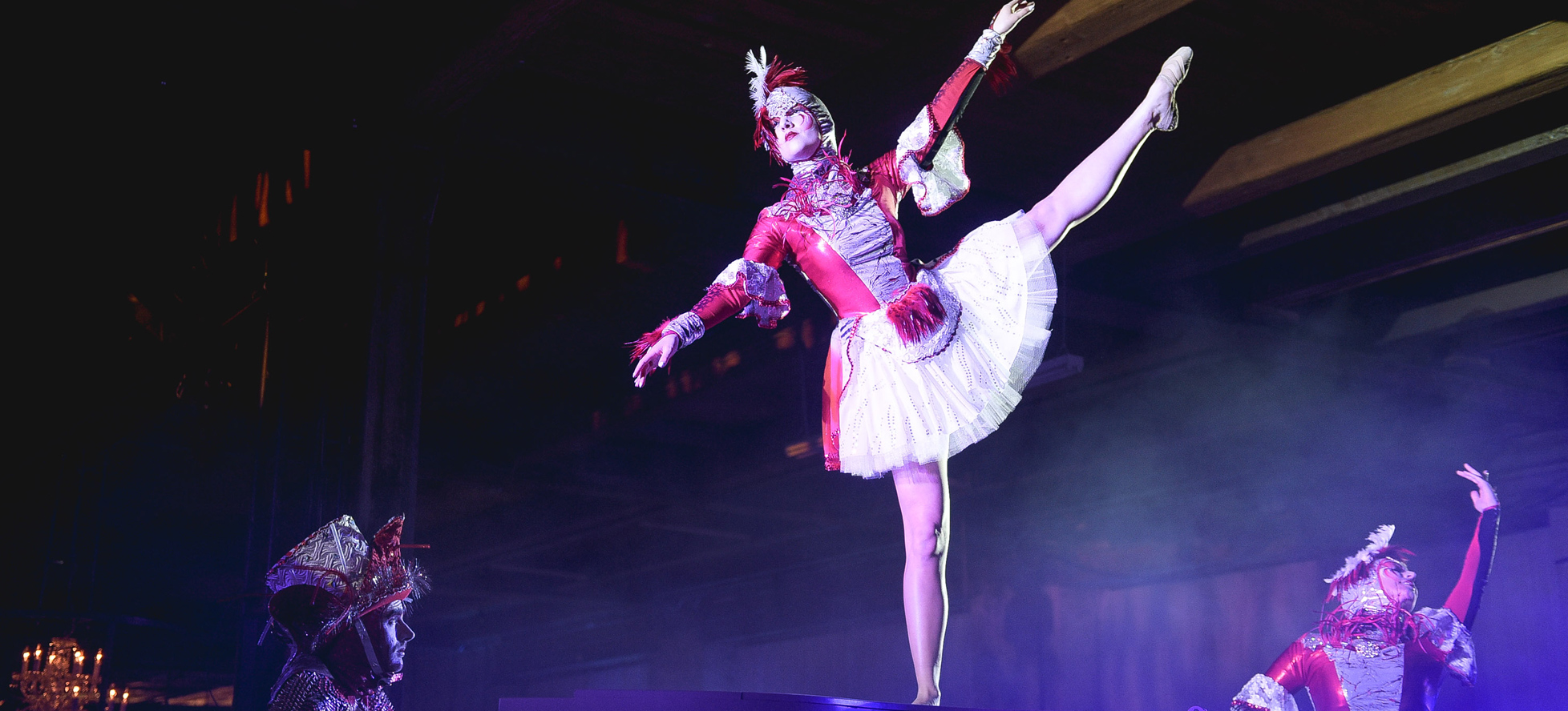 Dancer in costume with leg in the air