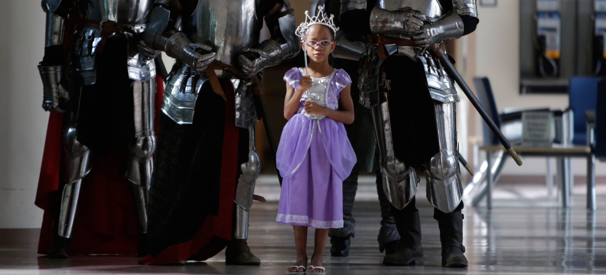 little girl dressed as princess with knights