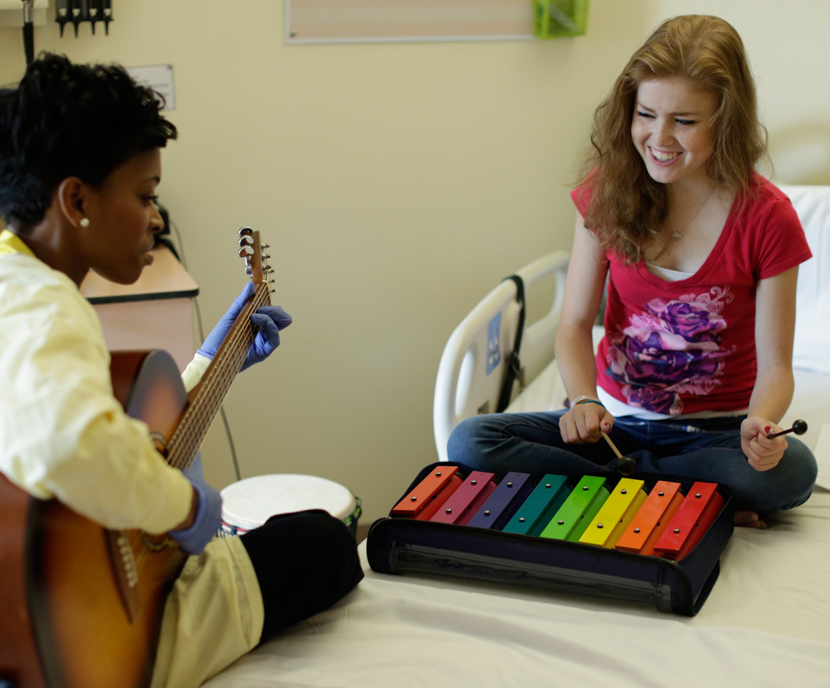 Girl in hospital room with xylophone