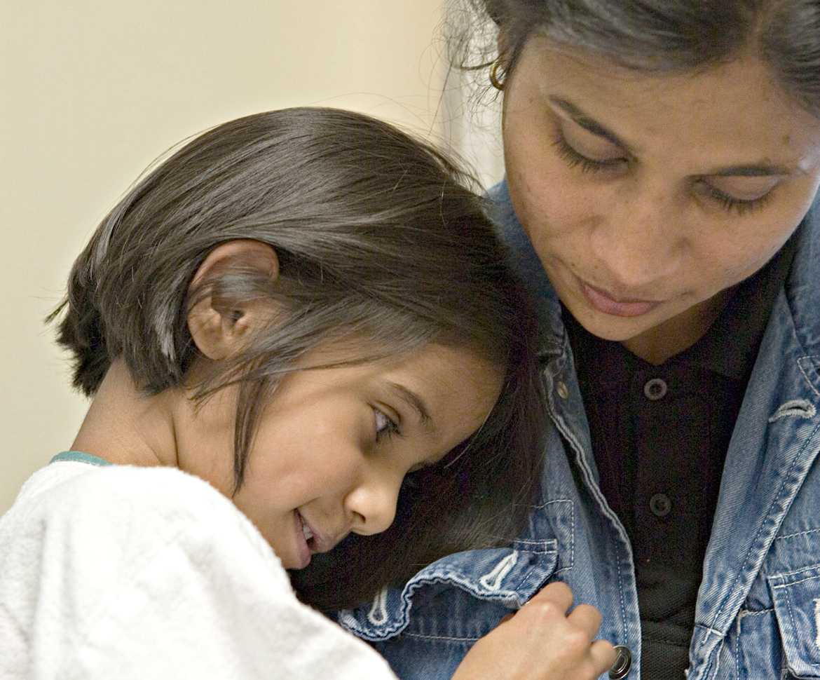 Girl hugging mom in jean jacket