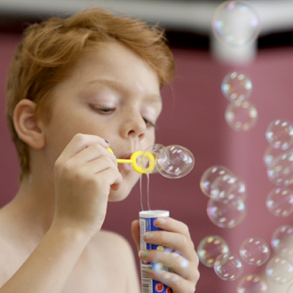 SickKids patient blowing bubbles
